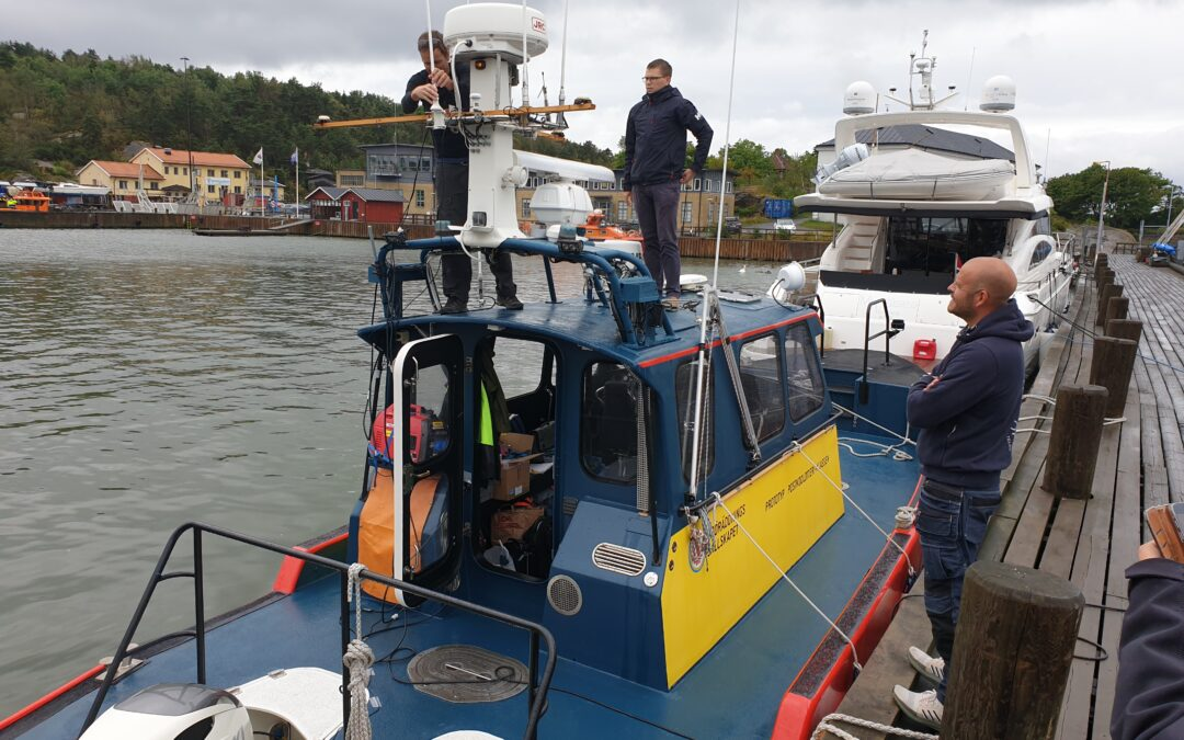 1. Adjusting antennas on one of our test vessels, Search and Rescue boat 11 00. The second test vessel, Motor Yacht @Sea, is visible in the background.